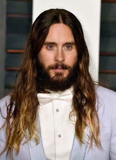 Caucasian with long hair and beard