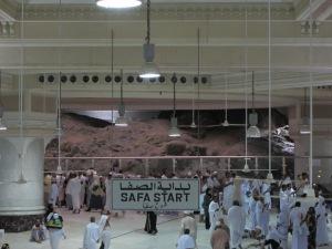 Pilgrims making dua at Safa facing the holy Kabah