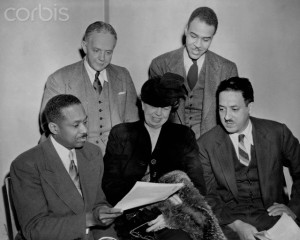 ca. 1947 --- Eleanor Roosevelt and Dr. James McClendon, board members of the NAACP, go over the 1947 program with NAACP executive officers Walter White and Roy Wilkins as Thurgood Marshall looks on. --- Image by © CORBIS