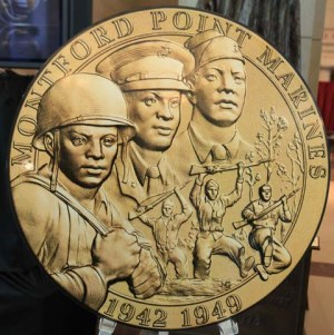 A oversized Congressional Gold Medal sits near the stage for all to see in Emancipation Hall in the Visitors Center at the US Capitol in Washington DC on Wednesday, June 27, 2012. In the 1940's 20,000 Montford Point Marines, the first Black Marines trained in a segregated camp in North Carolina and later fought in World War II mainly in the South Pacific. Roughly 300 are still living and were honored today with a very high honor, the Congressional Gold Medal by leading US House Representatives and United States Senators including Nancy Pelosi, the Democratic Leader of the US House of Representatives, Mitch McConnell, Republican Leader of the US Senate, Harry Reid, Majority Leader of the US Senate and John Boehner, the Speaker of the House. Eric Seals/Detroit Free Press