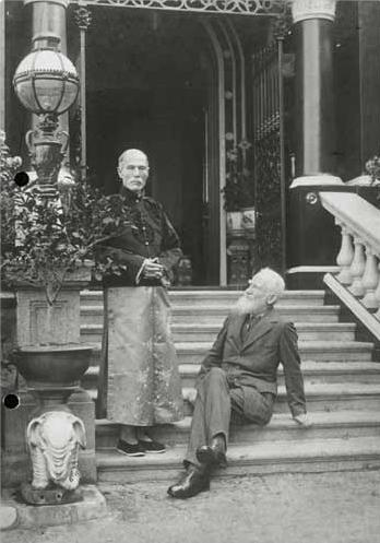 Sir George B. Shaw with man in Chinese dressing
