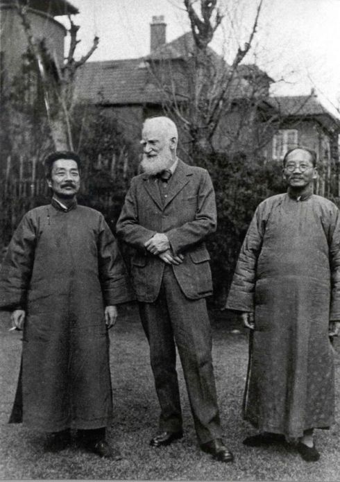 Sir George Bernard Shaw with Asian men