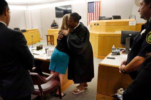 negro judge hugging murderer