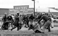 """FILE - In this March 7, 1965 file photo, state troopers use clubs against participants of a civil rights voting march in Selma, Ala. At foreground right, John Lewis, chairman of the Student Nonviolent Coordinating Committee, is beaten by a state trooper. The day, which became known as """"Bloody Sunday,"""" is widely credited for galvanizing the nation's leaders and ultimately yielded passage of the Voting Rights Act of 1965. (AP Photo/File) ORG XMIT: NY516"""