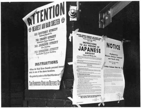 San Francisco, California. On a brick wall beside air raid shelter poster, exclusion orders were po . . .