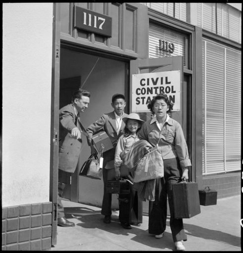 Oakland, California. Part of family unit of Japanese ancestry leave Wartime Civil Control Administr . . .