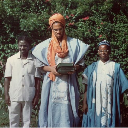 Color photo of Malcolm Shabazz in Muslim headwear